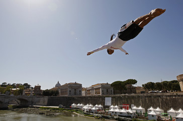 Cliff diver Orlando Duque of Colombia jumps into the Tiber river from the Ponte Sant'Angelo during a promotional event in Rome