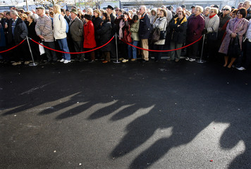 People wait during the opening of a new commercial centre in Ljubljana