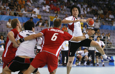Jung Suyoung of South Korea prepares to shoot at goal during their Group B men's handball game against Denmark at the Beijing 2008 Olympic Games