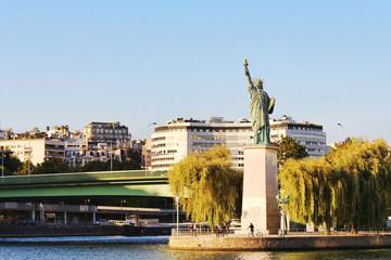 View on liberty statue, cygnes island, paris city, france