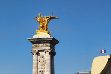 View on golden statue near Alexander III bridge, blue sky, paris city, france