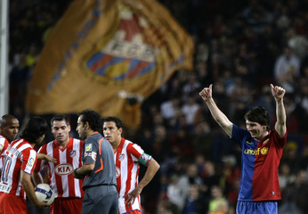 Barcelona's Lionel Messi celebrates his goal against Atletico de Madrid during their Spanish first division soccer match at Nou Camp stadium in Barcelona