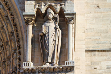 View on Notre-Dame Cathedral statue, front view, paris city, france