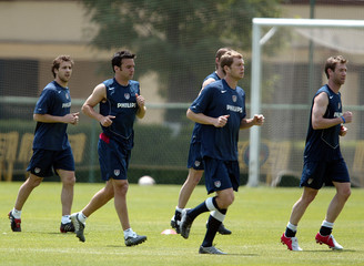 U.S. national soccer players run during a training session in Mexico City.