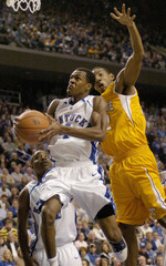 University of Kentucky's Rondo fights to get shot off under pressure from University of Tennessee's Smith in Lexington