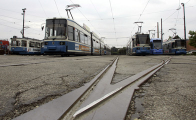 Non-active cable cars are pictured at a train station in Munich September 15, 2005. In six Bavarian ..