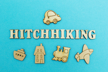 "The word ""hitchhiking"" and the figure of the car on a blue background from above, plane, train, ship, hotel - from below."