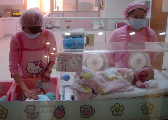 Nurses tend to a babies inside a Hello Kitty themed maternity ward inside a hospital in Changhua County