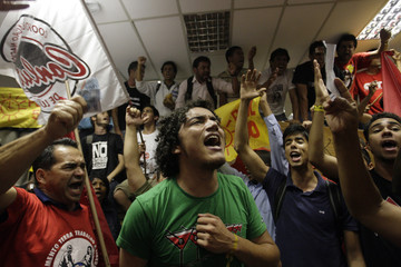 Brazilian students protest inside Brasilia's Legislative Chamber during a protest against Jose Roberto Arruda, the governor of the federal district of the capital Brasilia