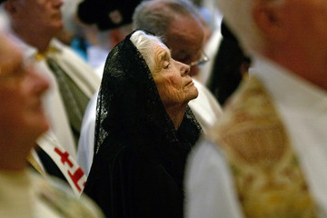 Woman prays during ordination of three Bishops to Roman Catholic Diocese of Brooklyn at Our Lady of Angels Church in New York