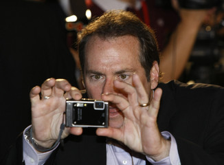 Director Stephen Sommers of movie G.I. Joe takes pictures at a red carpet ceremony in Tokyo