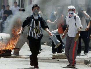 ECUADORAN STUDENTS THROW ROCKS AT RIOT POLICE.