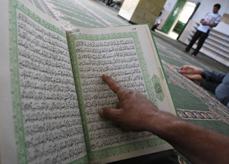A Palestinian reads the Koran in Hebron