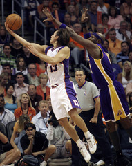 Suns Nash scores on a layup against Lakers Odom during NBA action in Phoenix