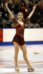 Sarah Hughes pauses after performing her free skate routine during the 2003 U.S. Figure Skating Cham..