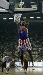 Anthony Greenup of Harlem Globetrotters scores against NY Nationals during exhibition game in Istanbul