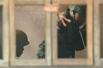 A soldier speaks by telephone inside the presidential residence in Tegucigalpa
