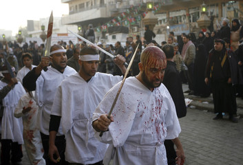 Shi'ite pilgrims take part in a religious procession of Ashura in Kadhimiya district in Baghdad
