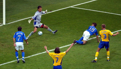 ITALY'S CASSANO SCORES AGAINST SWEDEN DURING EURO 2004 GROUP C MATCH IN PORTO.