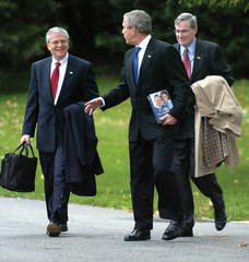 U.S. President Bush walks to Marine One for departure from the White House in Washington
