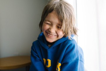 Girl smiling with eyes closed