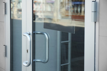 White glass door with sign on it, closeup
