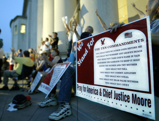 DEMONSTRATORS SIT OUTSIDE THE ALABAMA JUDICIAL BUILDING IN MONTGOMERY.