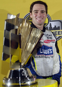 NASCAR Nextel Cup Series champion Johnson stands with his trophy after the top ten NASCAR drivers celebrated the end of their season with a lap through Times Square, in New York