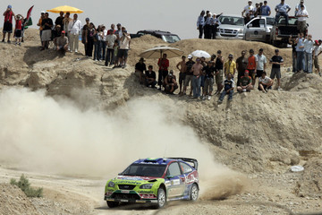 Matti of Finland drives his Ford on the second day of the Jordan Rally near the Dead Sea
