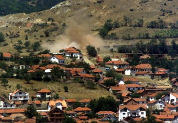 A HOUSE IN SLUPCANE VILLAGE IS HIT BY MACEDONIAN FORCES.