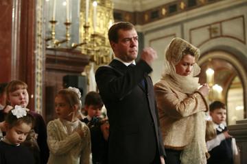Russia's President Dmitry Medvedev and his wife Svetlana attend an Orthodox Christmas mass at the Christ the Saviour Cathedral in Moscow