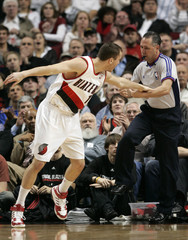 Portland Trail Blazers' Rodriguez gets his arm tangled with a referee during their NBA basketball game against the Toronto Raptors in Portland