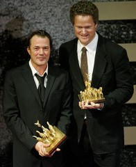 German director Henckel von Donnersmarck and actor Koch pose with their 'Die Quadriga' awards during the awarding ceremony in Berlin