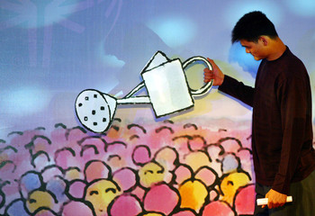 CHINESE SPORTS ICON YAO MING WATERS FLOWER IN SHANGHAI.