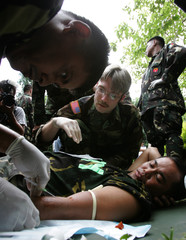 A U.S. army closely watch a Filipino soldier during a medical training.