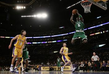 Boston Celtics Garnett dunks in fourth quarter of their game against the Lakers in Los Angeles