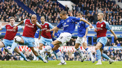 Everton's Rodwell shoots to score during their FA Cup fifth round soccer match against Aston Villa in Liverpool