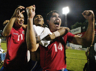 Costa Rican players celebrate their passing on to the next round.