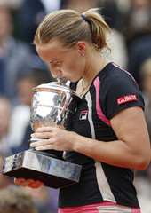 Kuznetsova of Russia kisses the trophy after winning her women's final against compatriot Safina at Roland Garros in Paris