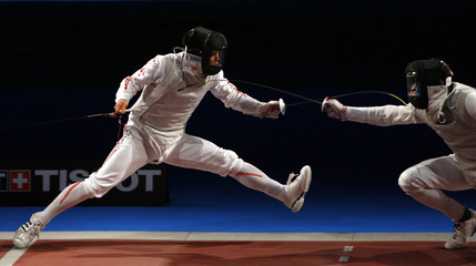 Japan'sChida competes with Meinhardt of the U.S. in the men's team foil quarter-final fencing event at the World Fencing Championship in Antalya