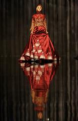 A model presents a creation by Indonesian designer Nuari during Islamic Fashion Festival in Kuala Lumpur