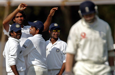 India Board President's XI Patel celebrates with teammates after taking wicket of England's Hoggard during three-day tour match in Vadodra