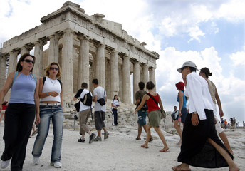 Tourists in Athens visit the Parthenon as the city prepares to host the 2004 Olympic Games.