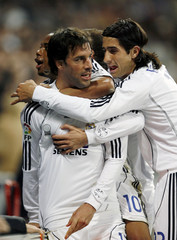 Real Madrid's Ruud van Nistelrooy is congratulated by his team mates after scoring against Getafe in Madrid