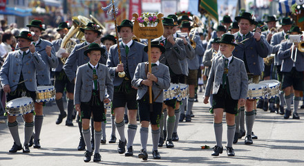 People in traditional clothes march during the Oktoberfest parade in Munich