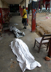 BODIES LIE ON GROUND AFTER MORTAR ATTACK IN MONROVIA.