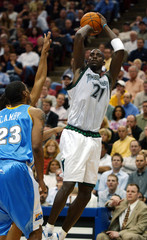 TIMBERWOLVES GARNETT SHOOTS OVER NUGGETS CAMBY.