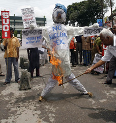 Activist from SUCI burns effigy of Indias PM Singh during protest in Siliguri