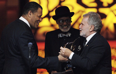 Fishburne congratulates Ganis after the film won Outstanding Motion Picture during the 2006 Black Movie Awards in Los Angeles
