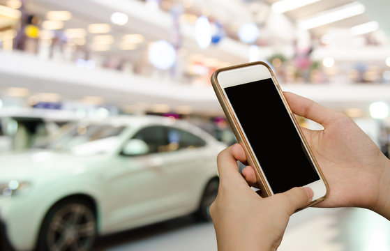 Woman using mobile smartphone at motor show event